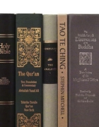 Religious texts image credit:juxtaposed-religion-bookshelf-2.jpg